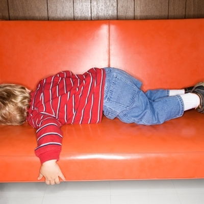 Kid sleeping on sofa